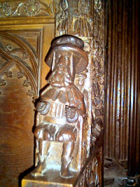 The 'Chester pilgrim' carved in the choir stalls.
